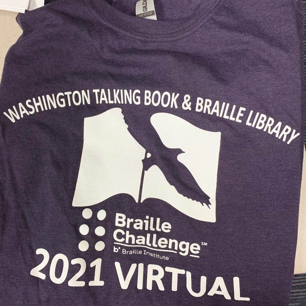 "Each student participant received a WTBBL Braille Challenge T-shirt. Has WTBBL logo, Braille Challenge logo, and says ""2021 Virtual""."